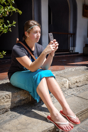 Mennonite girl grabing some snapshots of her visit to Antigua Guatemala