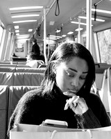 Street Photography — Train commuters spent their entire rides with their faces on the phones and ears all plugged up